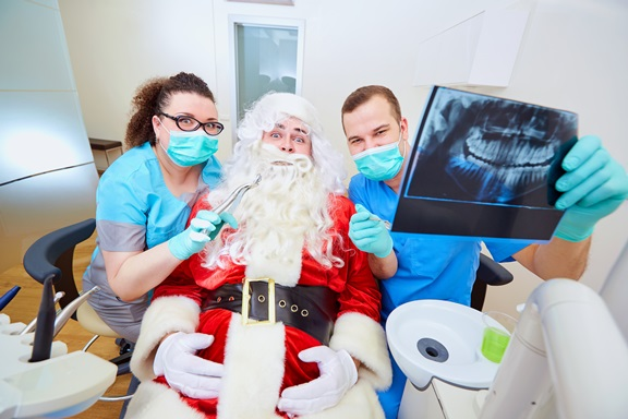 Funny concept of Santa Claus at the dentist's office on Christma